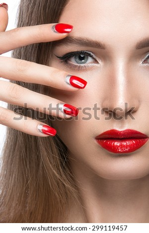 Beautiful young girl with a bright make-up and red nails. Beauty face. - stock photo