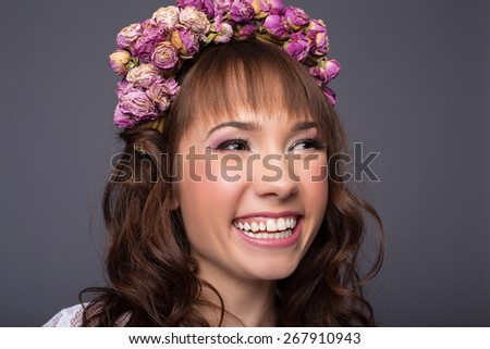 Beautiful young girl with a floral ornament in her hair - stock photo