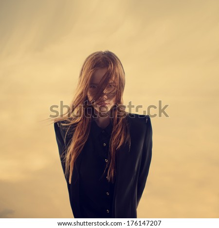 beautiful young girl with a gothic appearance - stock photo