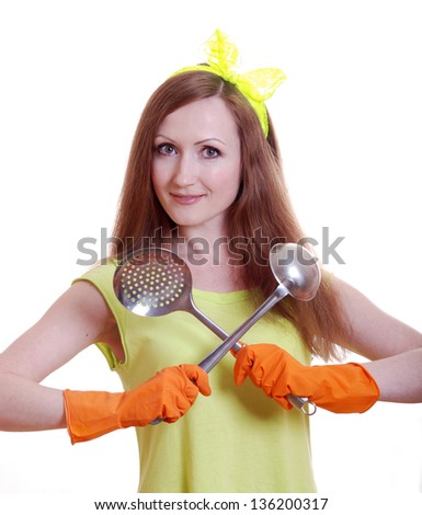beautiful young girl with a ladle in hand isolated on white background - stock photo