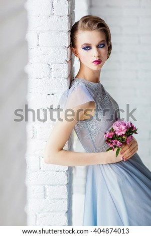 Beautiful young  girl with a wedding bouquet - stock photo