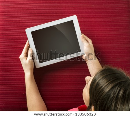 Beautiful young girl with blank white tablet - stock photo