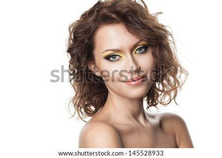 Beautiful young girl with curly hair and modern bright makeup - stock photo