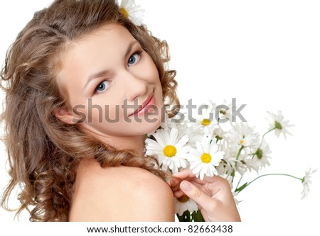 beautiful young girl with flowers - stock photo
