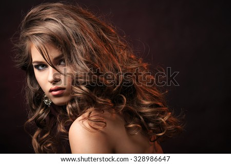 Beautiful young girl with make-up - stock photo