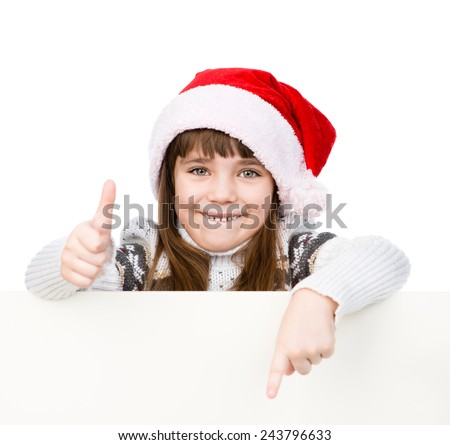 Beautiful young girl with santa hat standing behind white board. isolated on white background - stock photo