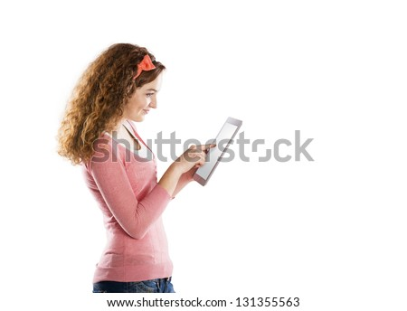 Beautiful young girl with tablet in studio - stock photo