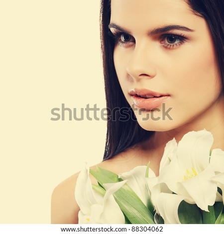 beautiful young girl with tulips, isolated on a white background - stock photo