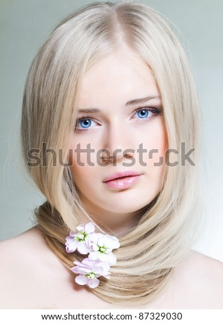 Beautiful young girl with white hair and blue eyes - stock photo