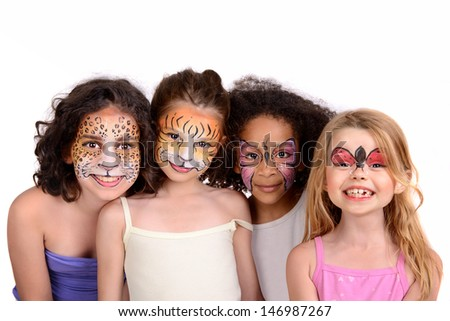 Beautiful young girls with animal painted faces - stock photo