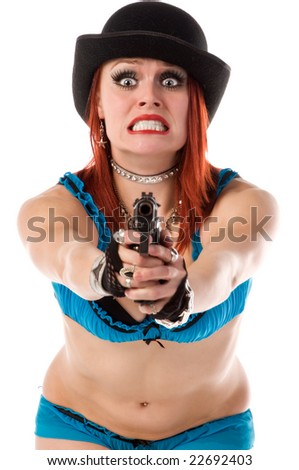Beautiful young go go dancer in blue lingerie and a bowler hat armed with a hand gun and terrified - stock photo