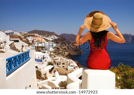 Beautiful young Greek woman on the streets of Oia, Santorini, Greece. - stock photo