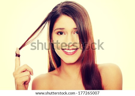 Beautiful young happy caucasian woman with healthy long hairs   - stock photo