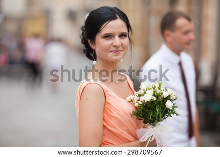 beautiful young happy stylish caucasian bride and groom on the background impressive architecture, Lviv, summer - stock photo