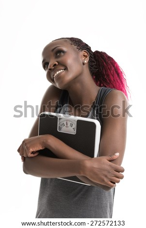 Beautiful young healthy african woman holding scales. Diet. Isolated on white background. - stock photo