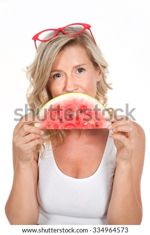 beautiful, young healthy, happy blond-haired woman smiling while holding a watermelon in his hands. Dietitian, diet, nutrition - stock photo