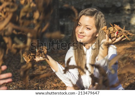 Beautiful young hispanic woman in autumn park - stock photo