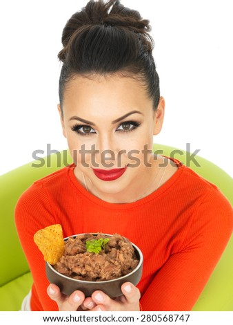 Beautiful Young Hispanic Woman In Her Twenties With Mexican Style Refried Beans Against A White Background - stock photo