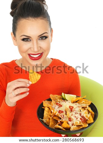 Beautiful Young Hispanic Woman With a Plate of Cheesy Nachos and Spicy Salsa Sauce Against A White Background - stock photo