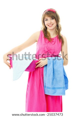 beautiful young housewife dressed in pink dress with a basin full of clothes - stock photo