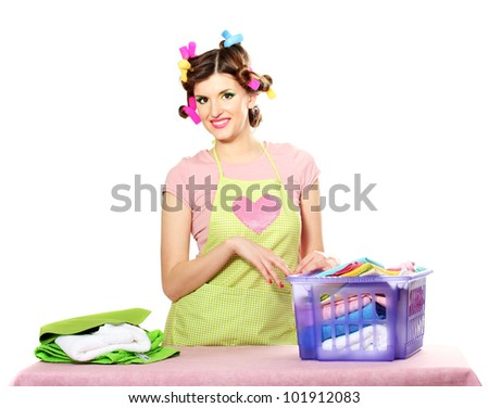 beautiful young housewife with basket of folded laundry isolated on white - stock photo