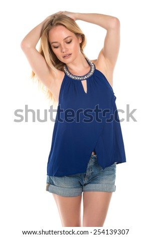Beautiful young Hungarian blonde in a blue blouse - stock photo