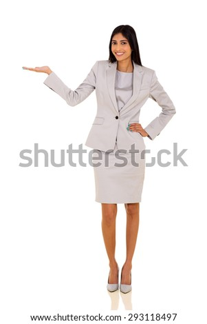 beautiful young indian businesswoman presenting on empty space - stock photo