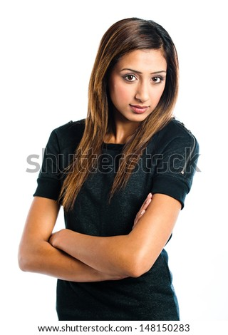Beautiful young Indian model posing with her arms folded  - stock photo