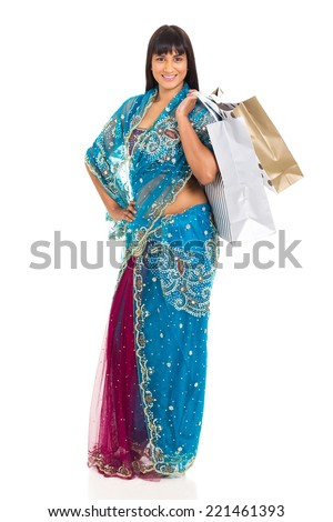 beautiful young indian woman shopping isolated on white - stock photo