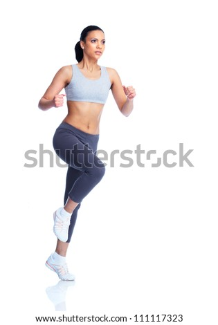 Beautiful young jogging woman. Isolated over white background. - stock photo