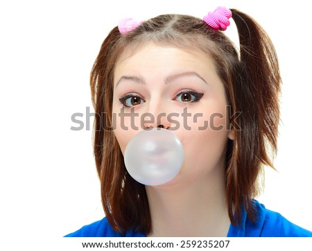 Beautiful young lady blowing big bubble gum on white background - stock photo