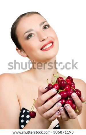 Beautiful young laughing girl holding a cherry on a white background - stock photo