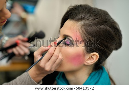 beautiful young model getting fashion make-up - stock photo