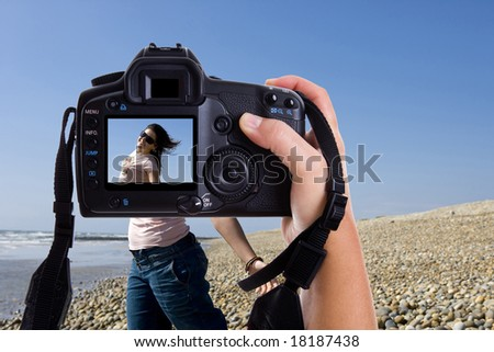 beautiful young model in a photography session with pro photographer - stock photo