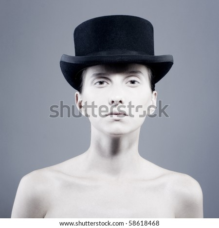 Beautiful young model in hat. Contrast photo - stock photo