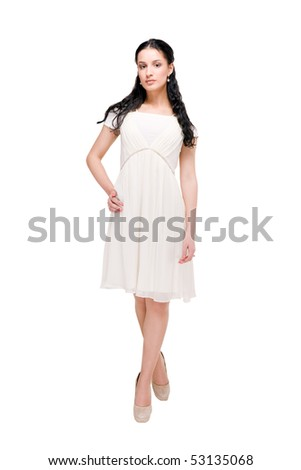 Beautiful young model in modern dress on white background - stock photo
