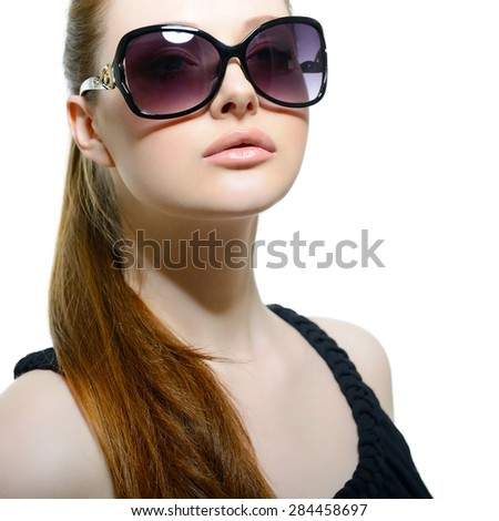 Beautiful young model with big sunglasses, close up. - stock photo