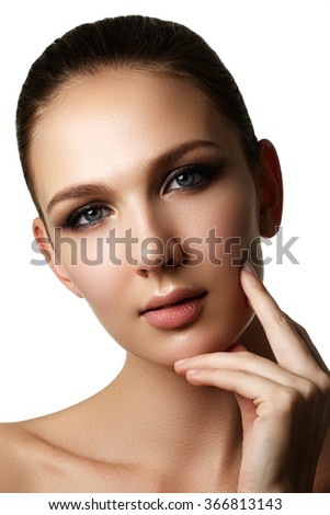 Beautiful young model with dark fashion make-up and french manicure. Purity skin. Beauty style. Fashion shiny highlighter on skin, sexy gloss lips make-up and dark eyebrows - stock photo