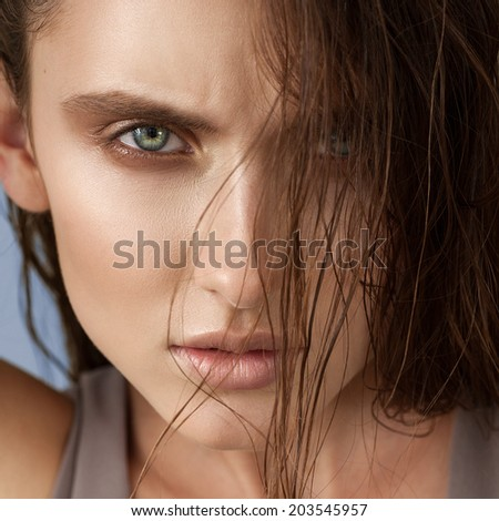 Beautiful young model with long wet hair, light makeup, fresh summer look with damp beach hairstyle - stock photo