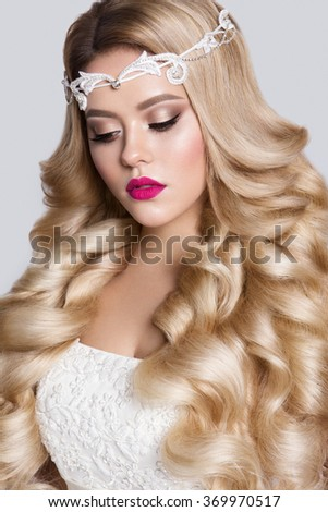 Beautiful young model with pink lips and curly hair - stock photo