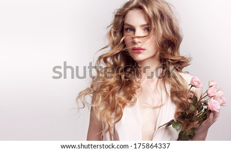 Beautiful young model with pink rose, bright makeup and manicure. Tender portrait - stock photo