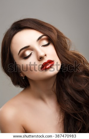 Beautiful young model with red lips. - stock photo