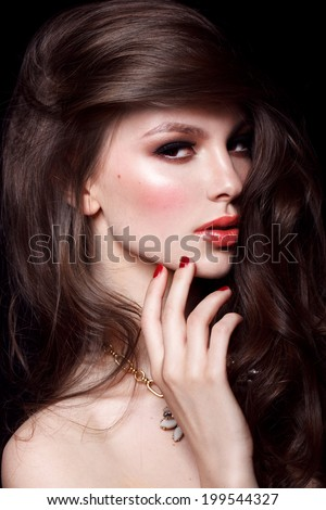 Beautiful young model with red lips and red manicure - stock photo
