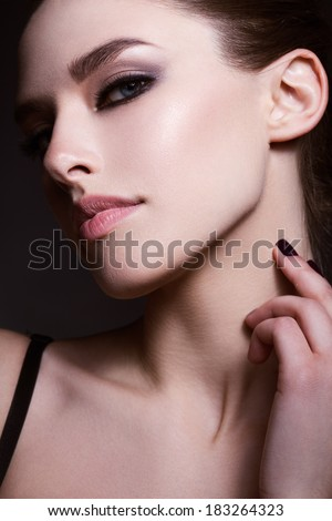 Beautiful young model with red lips. Provocative Make up. Gorgeous Woman Face. - stock photo