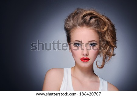 Beautiful young model with red lips wearing white  shirt - stock photo
