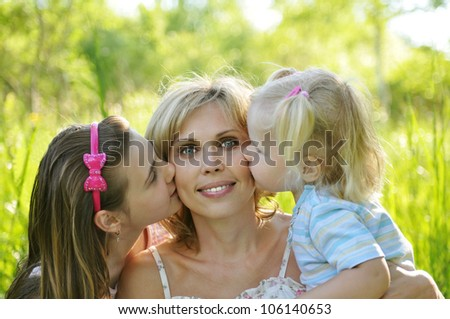 beautiful young mother and her daughter - stock photo