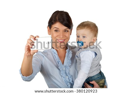 Beautiful young mother and her son taking a selfie - stock photo