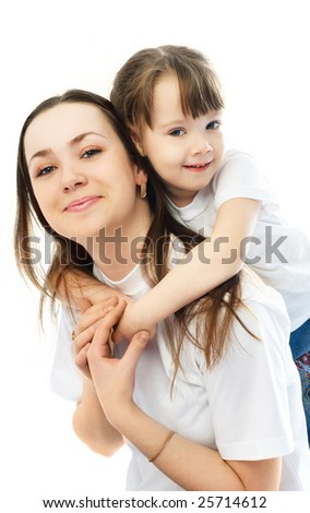 beautiful young mother giving her little daughter piggyback ride - stock photo