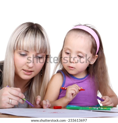 beautiful young mother teaching her cute little daughter drawing - stock photo
