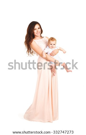 Beautiful young mother with a baby in a dress in full-length isolated - stock photo